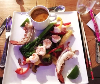 Red Thai Curry with Tiger Prawns and half lobster on a bed of stir fried vegetables served with coconut jasmine rice